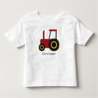 El tractor rojo apenas añade nombre playera de bebé