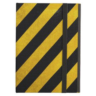 El tráfico negro y amarillo raya la caja del iPad