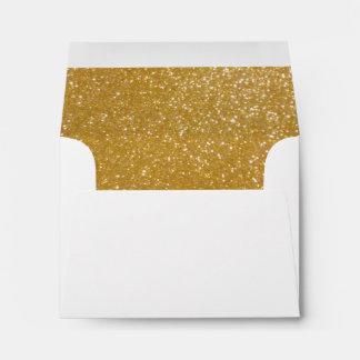 El trazador de líneas del oro envuelve chispas sobres