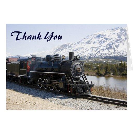 El tren blanco del paso en nieve le agradece carda tarjeta pequeña