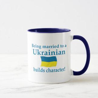 El ucraniano construye el carácter taza