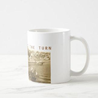 El venir 'alrededor de la vuelta taza