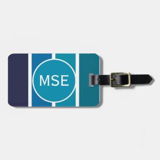 El verde azul raya el monograma del modelo etiqueta de equipaje