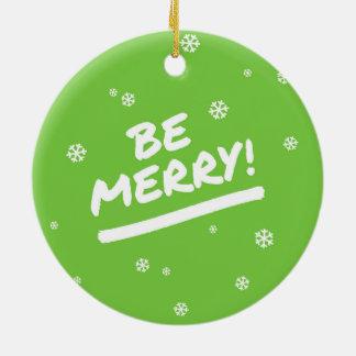 El verde de la diversión sea felices copos de adorno navideño redondo de cerámica
