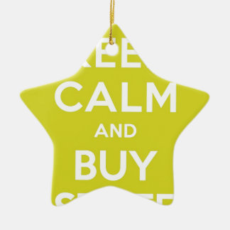 El verde mantiene tranquilo y compra materia adorno navideño de cerámica en forma de estrella