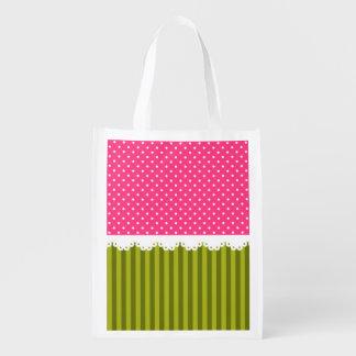 El verde rosado lindo del lunar raya el modelo bolsas reutilizables