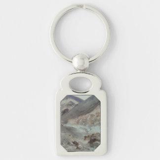 El viajar a través de terreno montañoso áspero llavero plateado rectangular