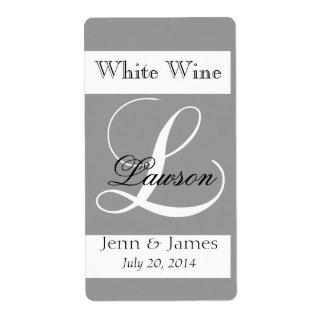 El vino del boda etiqueta el monograma L del gris
