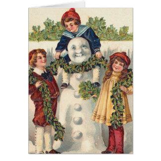 El vintage embroma el muñeco de nieve del edificio tarjeta de felicitación