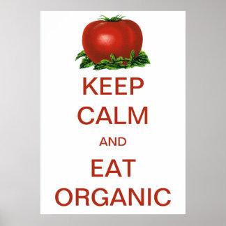 El vintage guarda calma y come el tomate orgánico póster