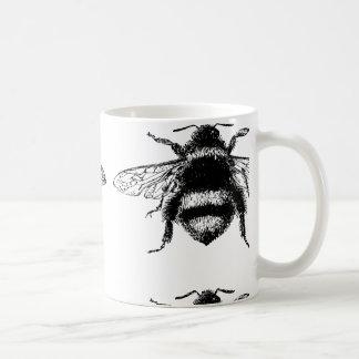 El vintage manosea la abeja taza de café