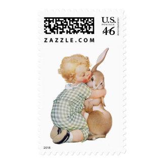 El vintage Pascua, niño con el conejo de conejito, Sello