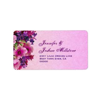 El vintage púrpura rosado bonito florece la etique etiqueta de dirección