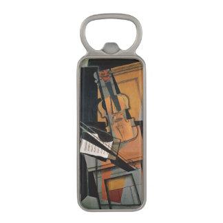 El violín, 1916 abrebotellas magnético