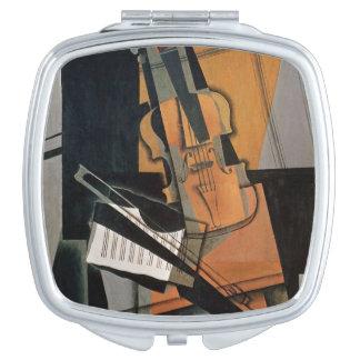 El violín, 1916 espejos compactos