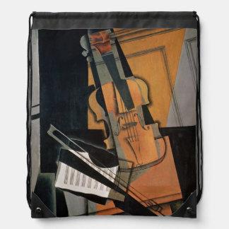 El violín, 1916 mochila