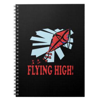 El volar arriba libros de apuntes