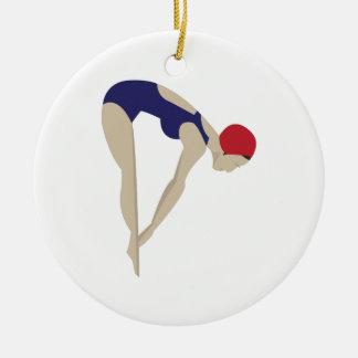 El zambullirse adorno navideño redondo de cerámica