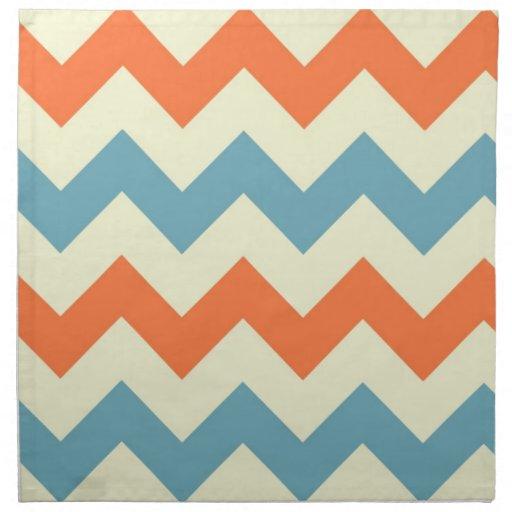 El zigzag azul anaranjado del galón raya el modelo servilletas