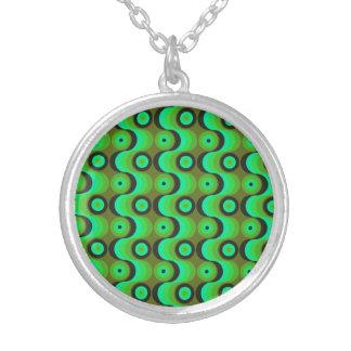 El zigzag curvado alinea los años 70 verdes de los colgantes