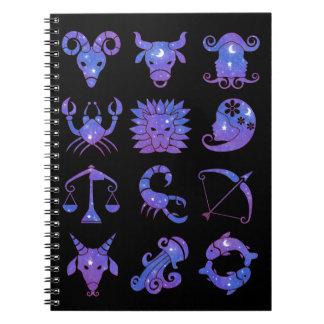 El zodiaco firma el cuaderno en azul estrellado