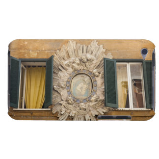 elaborate shrine squeezed between shuttered barely there iPod case