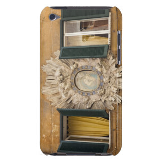 elaborate shrine squeezed between shuttered Case-Mate iPod touch case