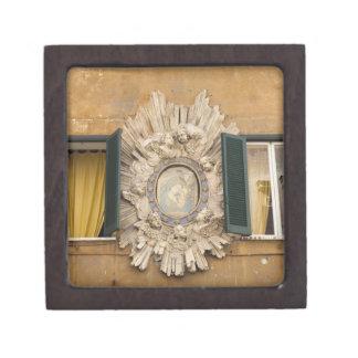 elaborate shrine squeezed between shuttered premium jewelry box
