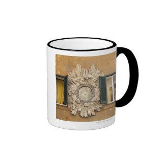 elaborate shrine squeezed between shuttered ringer mug