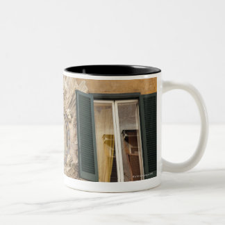 elaborate shrine squeezed between shuttered Two-Tone coffee mug