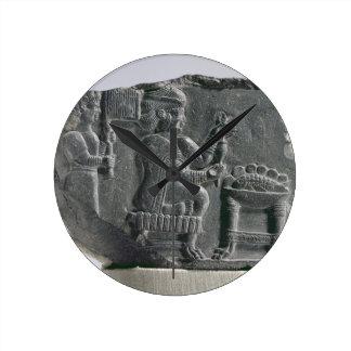 Elamite woman spinning, Neo-Elamite Period, c.700- Round Clock
