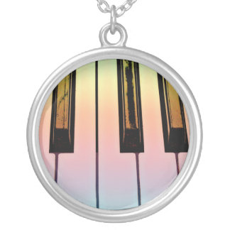 electric keyboard with rainbow overlay silver plated necklace