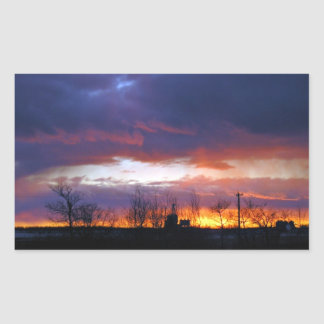 Electric power line against colorful sky at sunse rectangle sticker