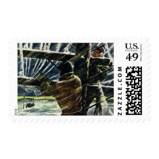 Electricistas del vintage que trabajan en una sello