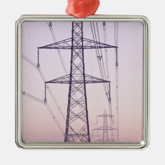 Electricity pylons in mist at dawn. square metal christmas ornament
