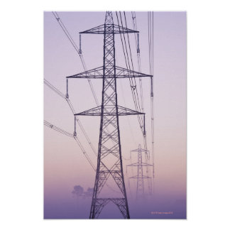 Electricity pylons in mist at dawn. poster