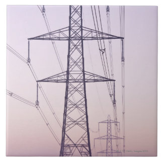 Electricity pylons in mist at dawn. tile
