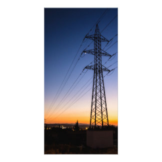 Electricity tower close to an urban area card