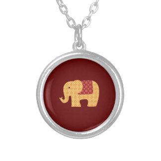 Elefante anaranjado lindo de la flor en rojo colgante redondo