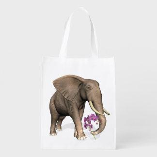 Elefante con la orquídea rosada bolsa de la compra