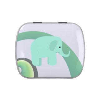Elefante con un fondo del arco iris frascos de caramelos