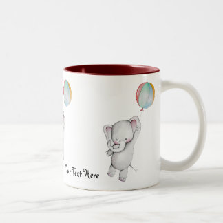 Elefante del bebé con la taza del globo