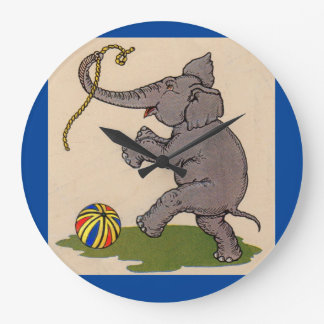 elefante feliz que juega con la cuerda y la bola reloj redondo grande