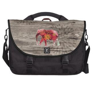 Elefante floral colorido caprichoso en el diseño d bolsas de portátil