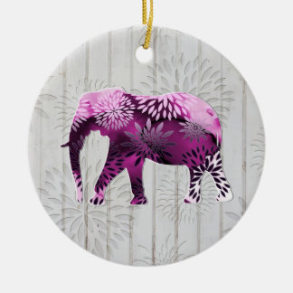 Elefante floral colorido caprichoso en el diseño adorno redondo de cerámica