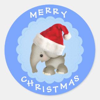 Elefante lindo en pegatinas azules del navidad del etiqueta redonda