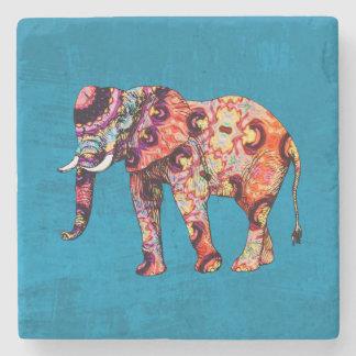 Elefante multicolor colorido en fondo azul posavasos de piedra