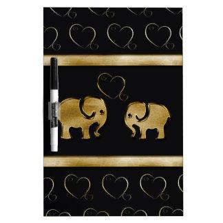 Elefante negro de lujo lindo de moda de /golden en pizarras