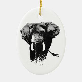 Elefante que camina adorno ovalado de cerámica