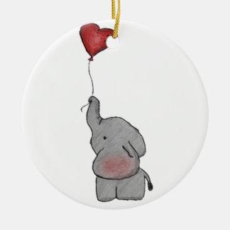 Elefante que sostiene el globo adorno navideño redondo de cerámica